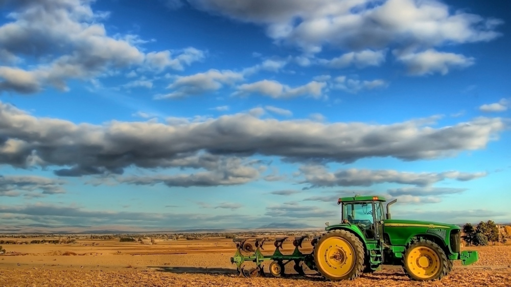 tractor_field_plowing_clouds_agriculture_51977_3840x2160